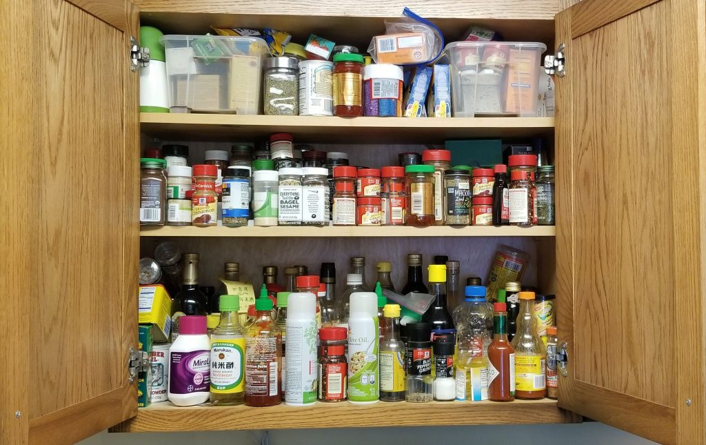spice cabinet before organizing