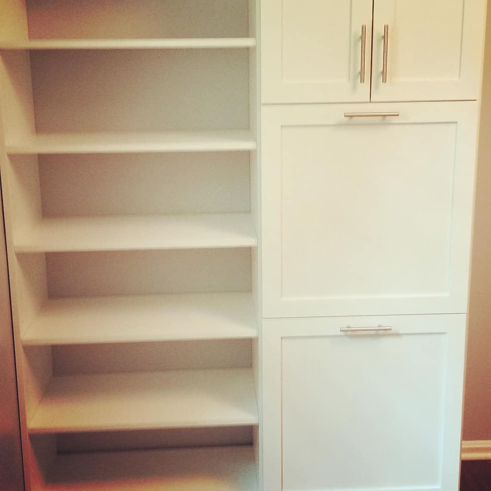 Two hampers, linen closet, and shelf space in dream closet