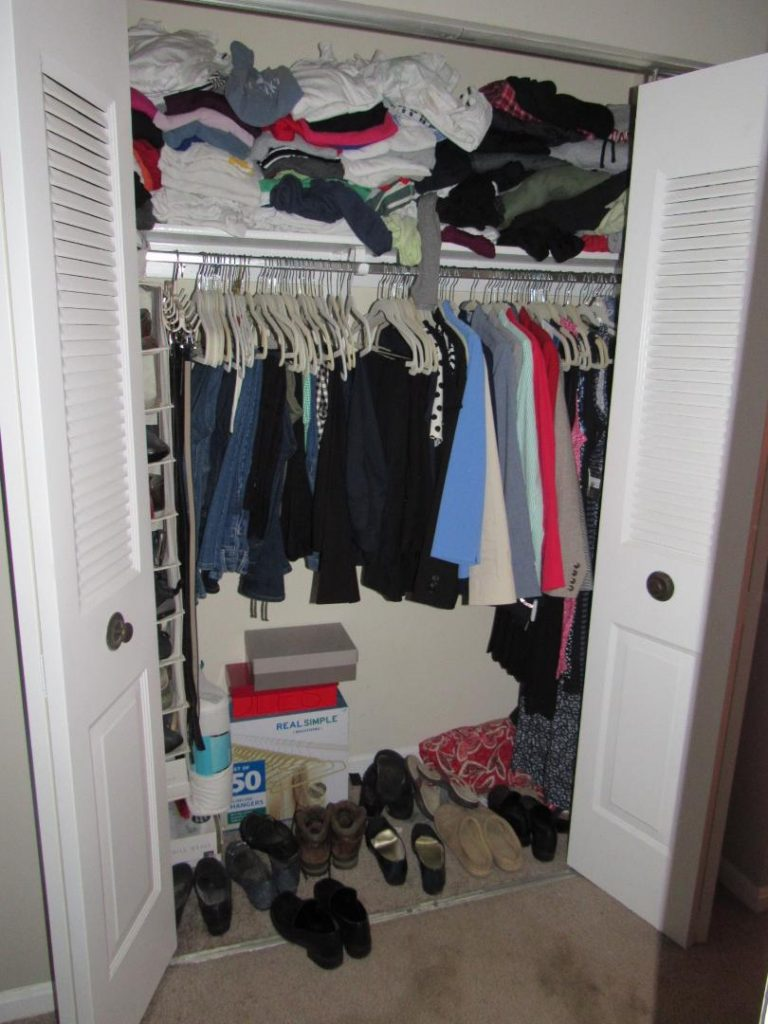 Old Closet With Clothes Piled Up On The Shelves, Shoes All Over The Floor,