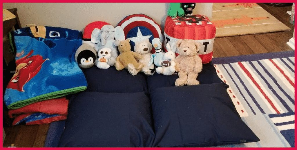 giant pillow with blankets and stuffed animals