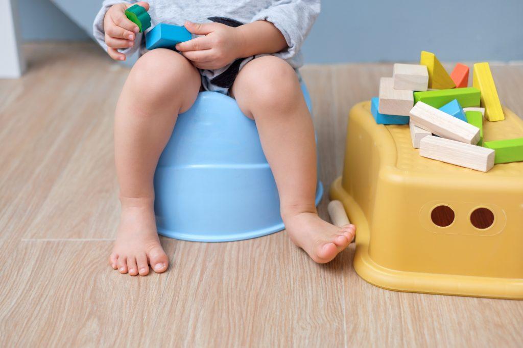 toddler sitting on potty training potty