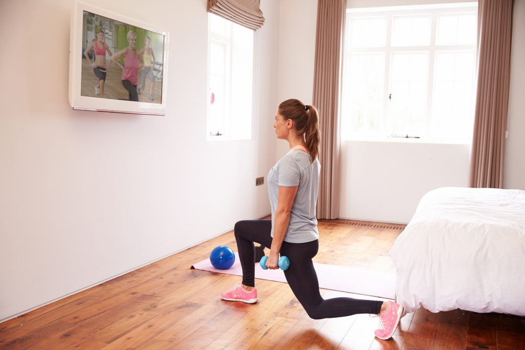 Woman working out to an exercise video
