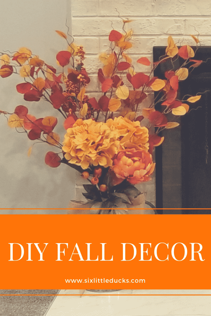 DIY Fall Decor pitcher with flowers and a bow