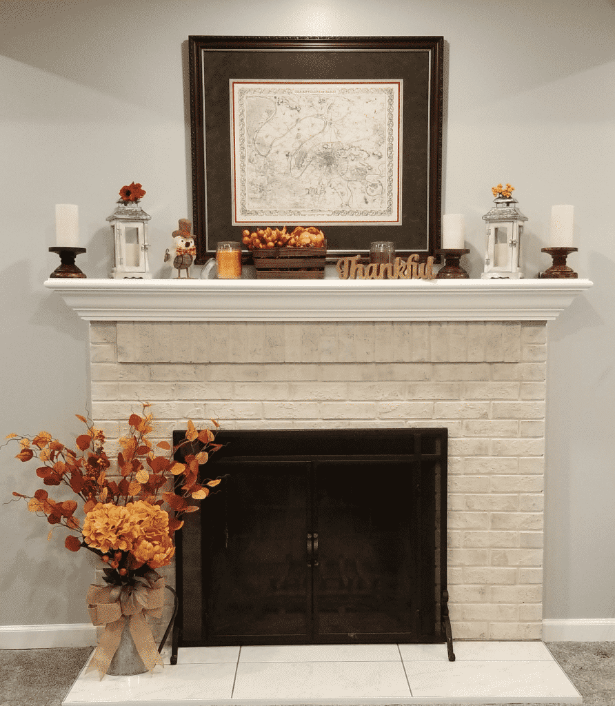 Completed fall decorated mantel and hearth
