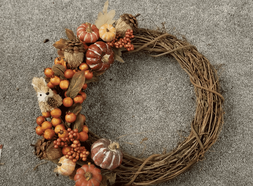 completed grapevine wreath with pumpkins, acorns, berries, and squirrel