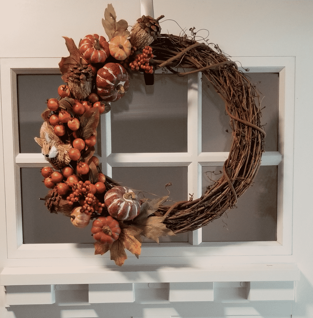Grapevine wreath with berries and pumpkins