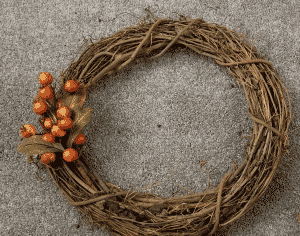 Grapevine wreath with one sprig of berries