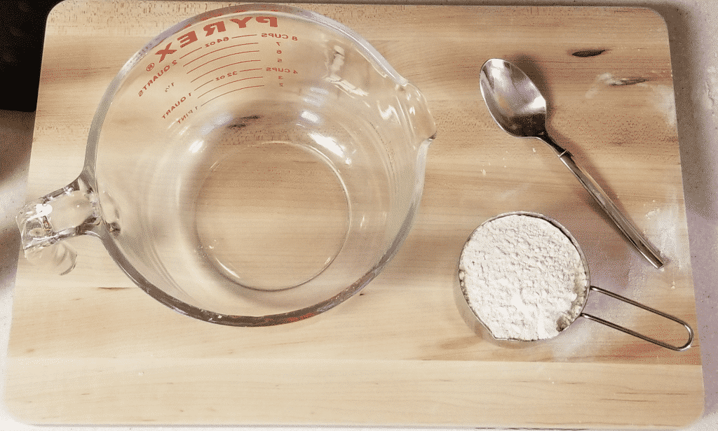 measuring flour to add to bowl