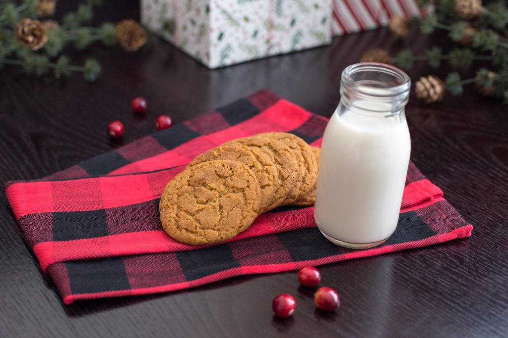 chewy ginger molasses cookies with milk