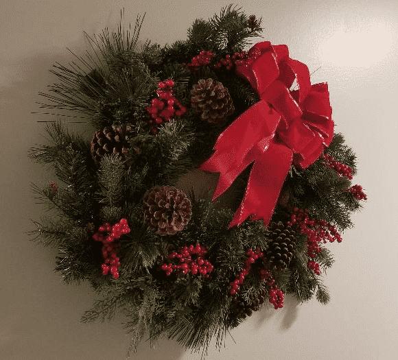 Hallway wreath with red velvet bow