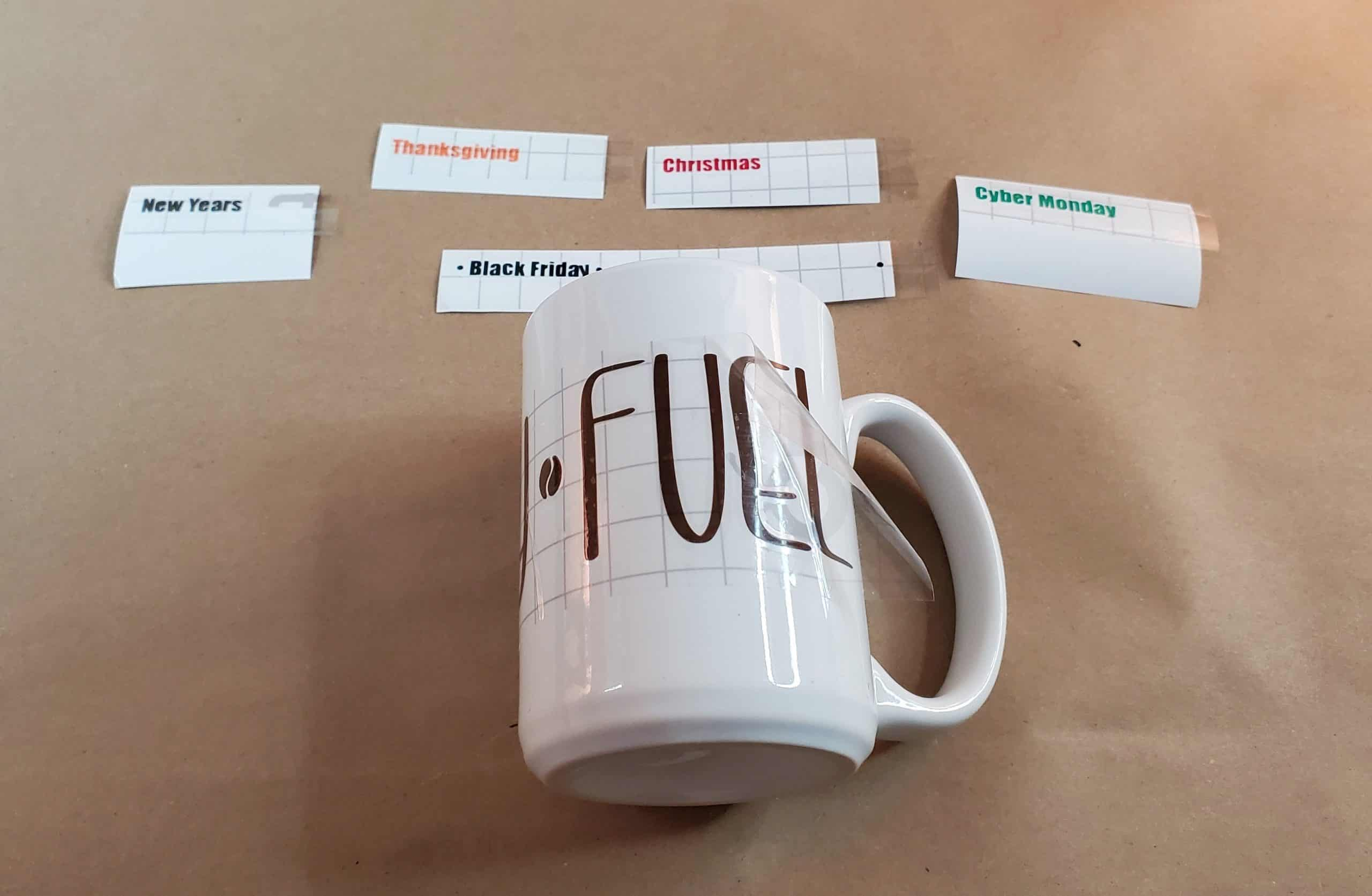 Applying vinyl lettering to mug