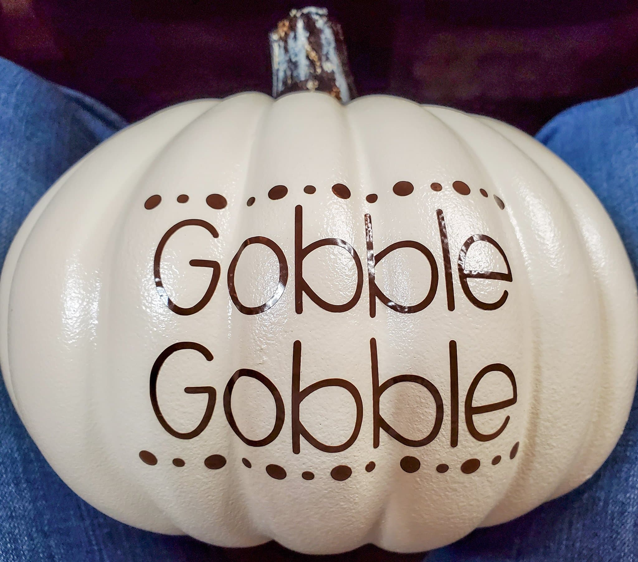 rows of brown dots applied to pumpkin above and below Gobble Gobble