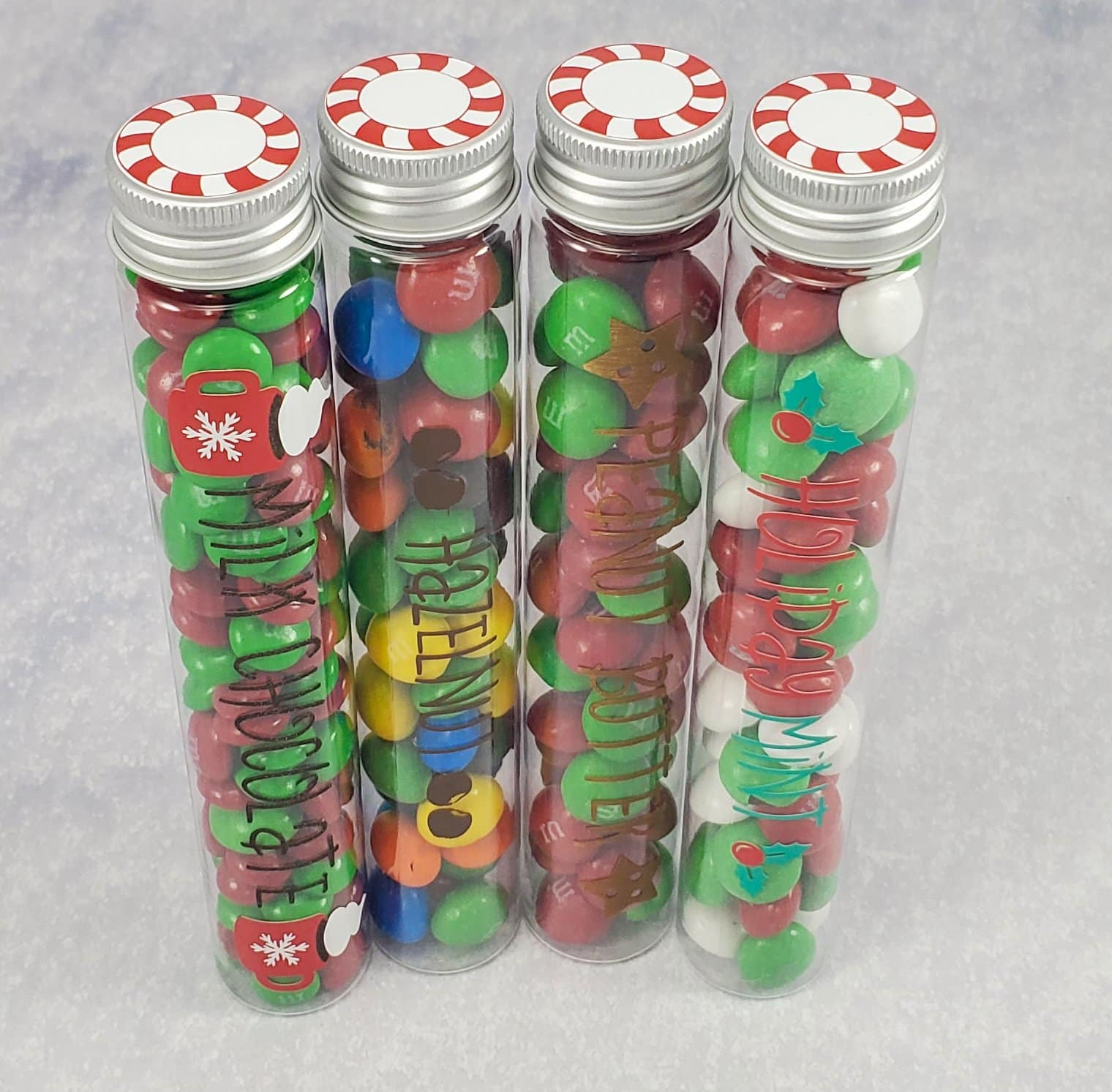 Four candy container tubes filled with candy