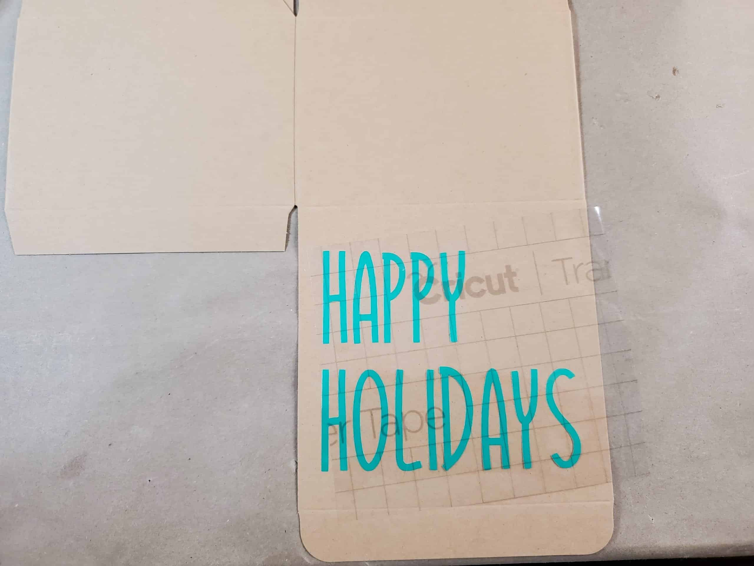 Happy Holidays Lettering Attached to Box