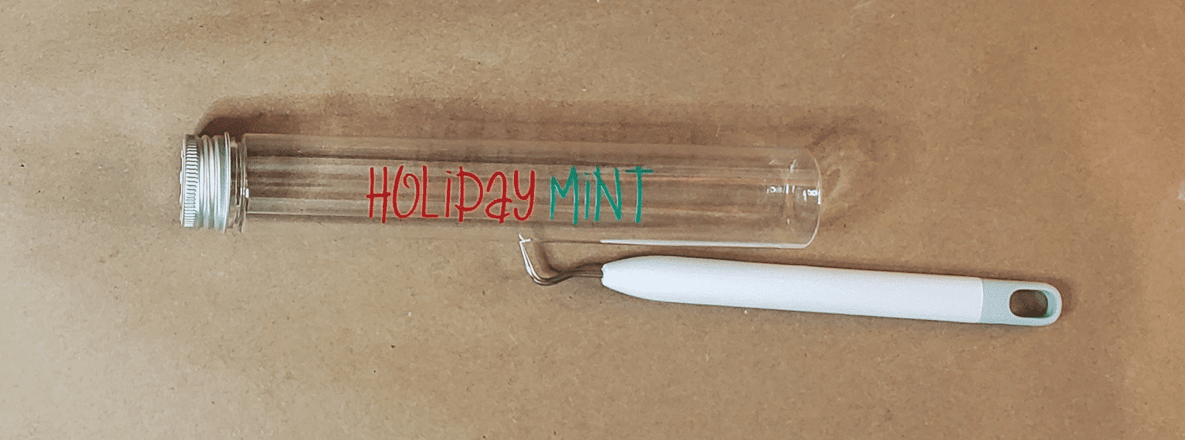 Holiday and Mint lettering on tube