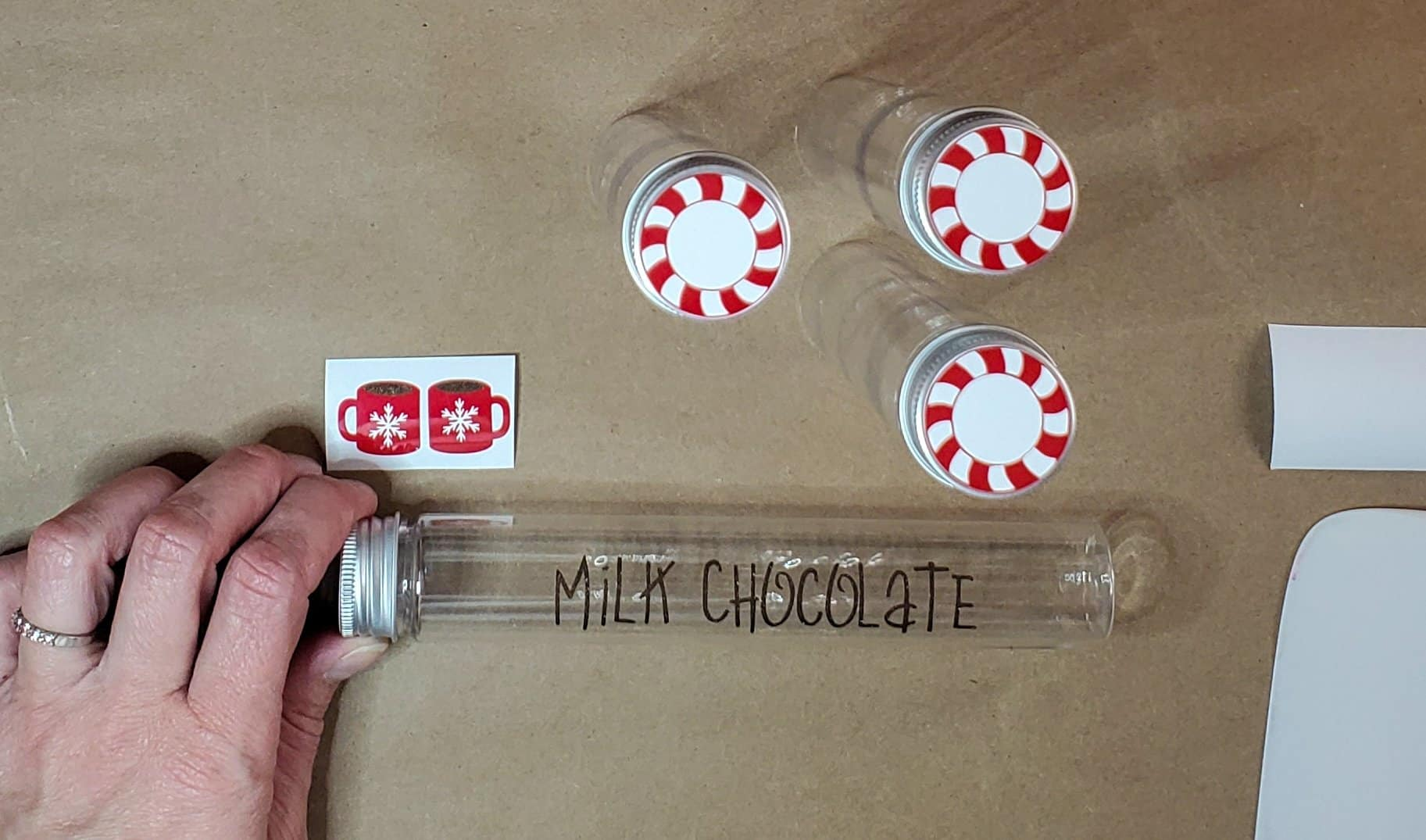 Milk chocolate lettering on container tube