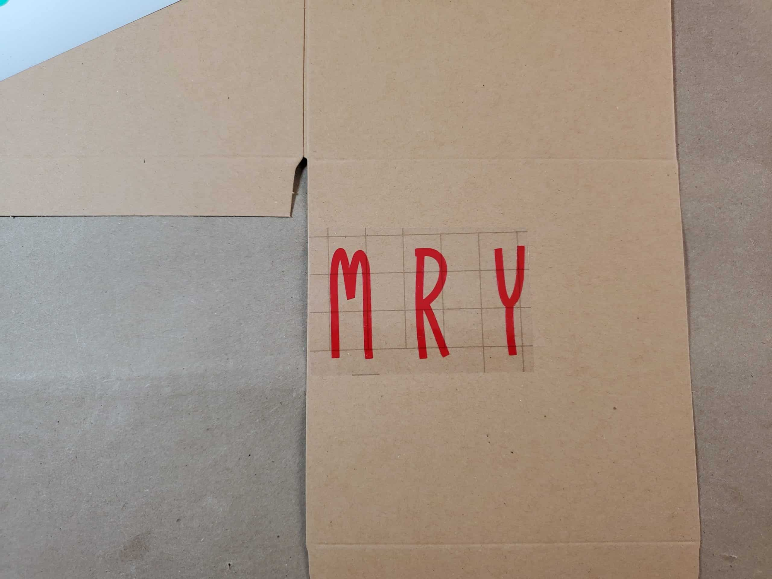 Attaching the M R Y (in Merry) to Box using transfer tape